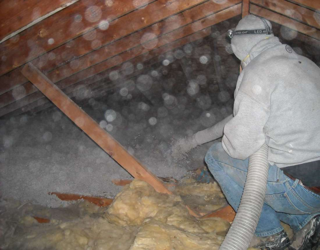 Using Cellulose for Attic Insulation: A Side-by-Side Comparison - blowing in a heavy blanket of cellulose