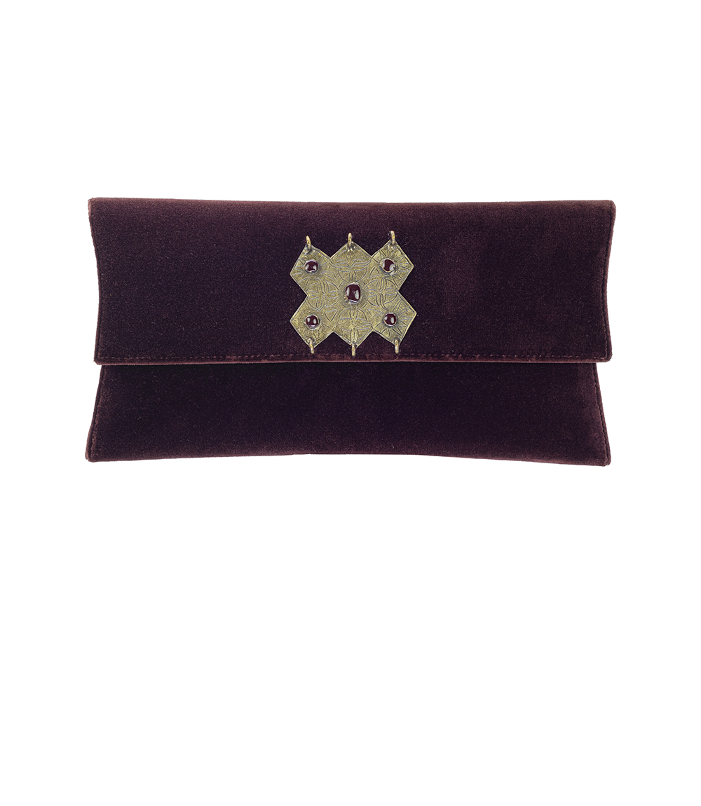 The Luz Clutch is handmade in Portugal out of soft suede and is embellished by a round lapidated sodalite stone set in gold metal.