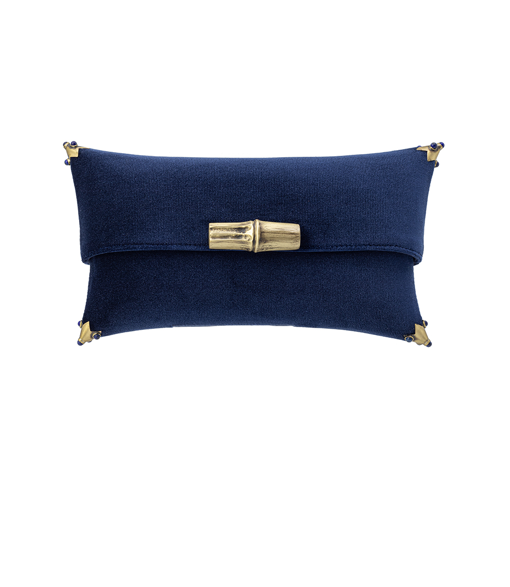 The Viola Clutch is carefully handmade in Portugal, out of velvet and lined in suede on the inside.