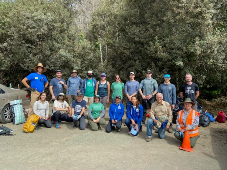 The Bay Area Climbers Coalition poses for a group photo with members of the National Park Service at Stinson Beach