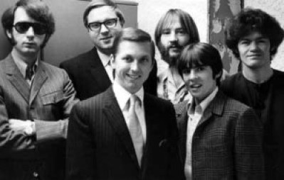 1260/KYA's Johnny Holliday (center) and Chris Edwards (second from left) meet Michael Nesmith, Peter Tork, Davy Jones and Micky Dolenz of The Monkees
