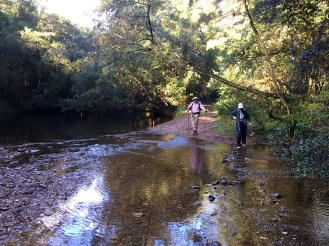Mary and leader Rodney prepare to cross the creek at the ford.