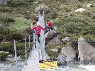 No hands, Sharon on the swing bridge.