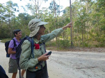 Leader Mary with Heather points out a habitat tree.