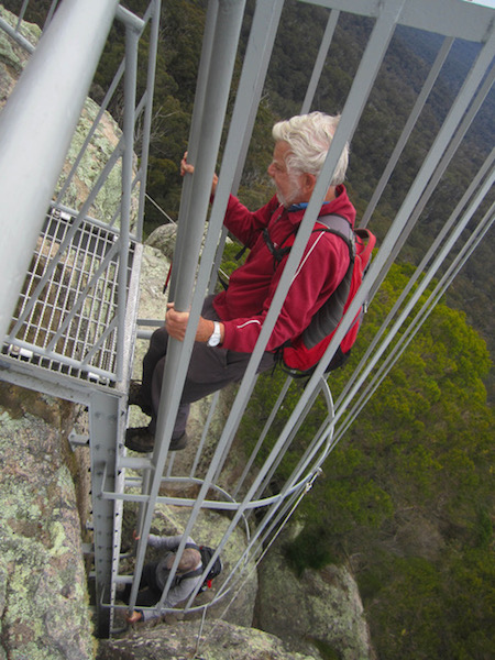 Geoff on the last ladder to the Peak