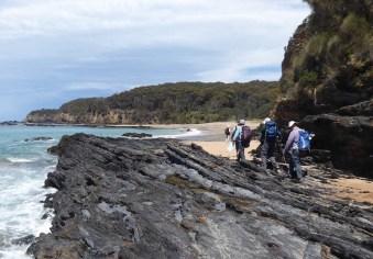 Rounding the rocks to the beach