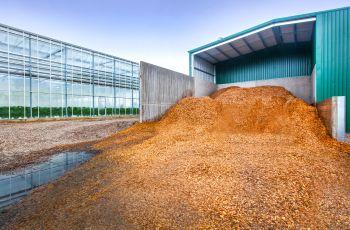 Prize-winning glasshouse burns green waste, eliminating 3,500 tonnes of CO2 emissions
