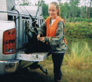 Avon Park Bombing Range -- Molly -- FIRST HOG TAKEN WITH A SHOTGUN SHE GOT FOR HER 13TH BIRTHDAY -- in front of dogs!!