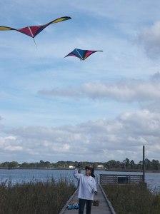 women flying kites