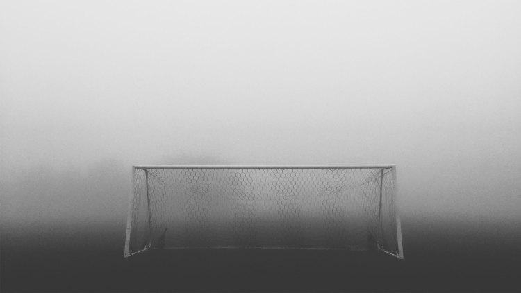 soccer goal surrounded by fog