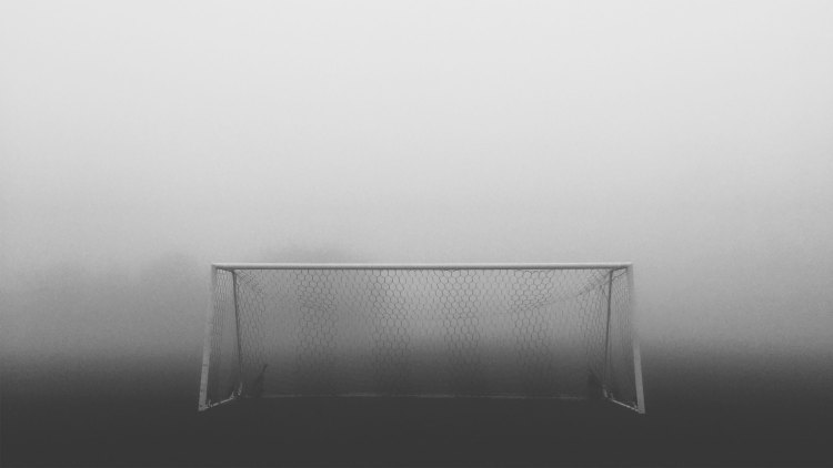 soccer goal surrounded by fog