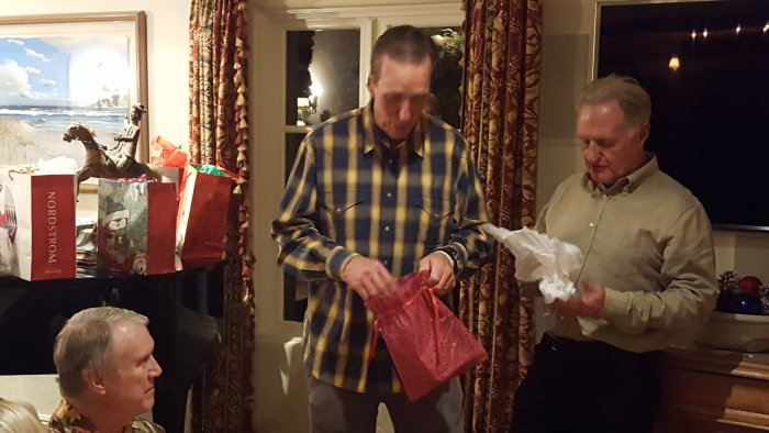 Bay Shore Church Fellowship Club opening white elephant gifts.