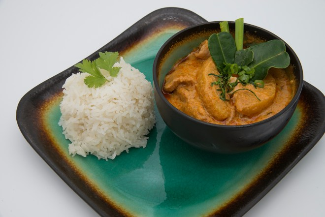 authentic thai food plated in bowl side of rice; Panang