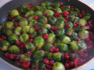 photo of sprouts and cranberries cooking in skillet