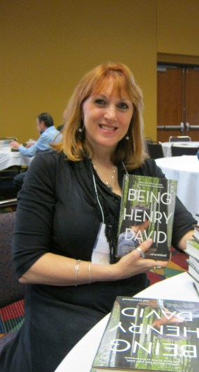 holding a copy of Being Henry David