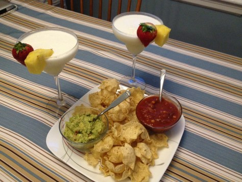 pina coladas with chips, guacamole, and salsa