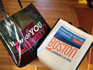 two library-themed tote bags