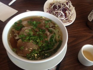 Bowl of pho with one of the additions (bean sprouts)shown