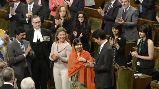 Malala Yousafzai is greeted by Parliament