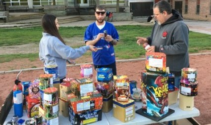 David Bryant, centre, and friends prepare firerworks for use Monday