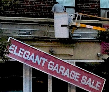 Elegant Garage Sale sign lowerd to sidewalk