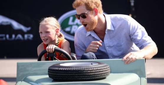 Prince Harry gets ride from girl in her pint-sized Land Rover