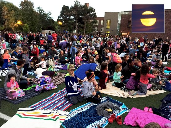Maurice Cody outdoor movie night with Harvest Moon above