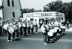 Lake Training Band in the 1961 parade at Kinnickinnic and Dover. The house and gas station were replaced in 1993 by the Bay View Library.  — courtesy Ron Winkler