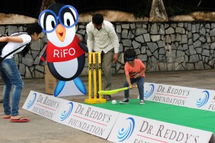 And that's four runs - little boy hits the ball blindfolded