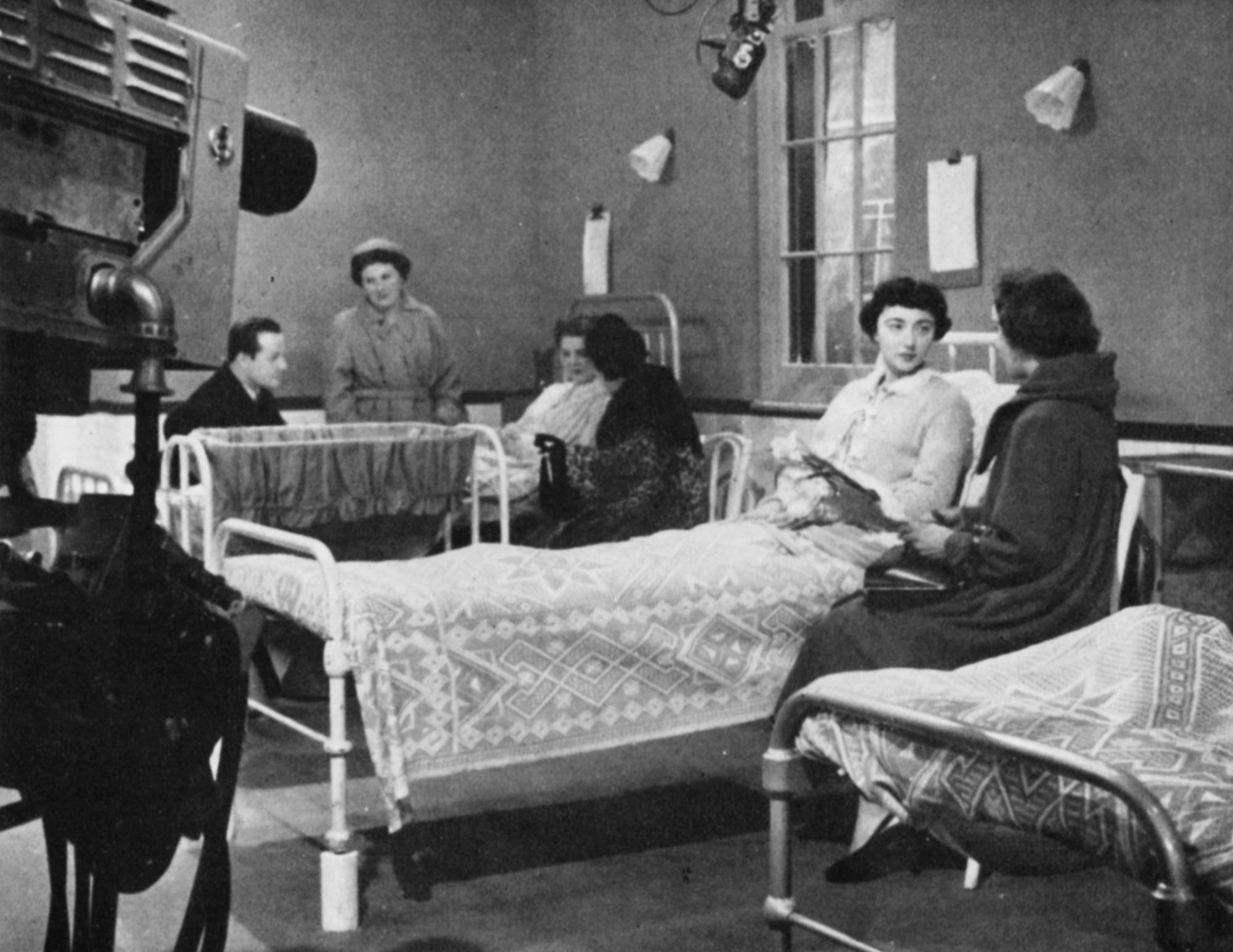 Women in a maternity hospital with visitors