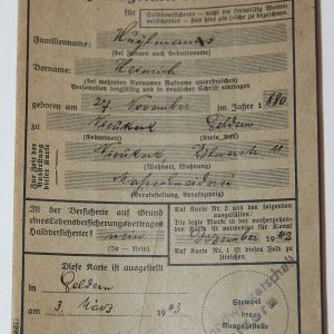 R079. WWII GERMAN NAMED EMPLOYEE INSURANCE CARD WITH PARTY STAMPS