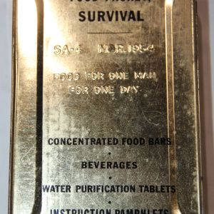 T021. PRE VIETNAM 1954 DATED SA-4 SURVIVAL FOOD PACKET TIN