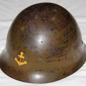 L010. WWII JAPANESE TYPE 90 NAVAL LANDING FORCE HELMET WITH INSIGNIA