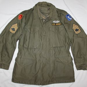 T046. PRE VIETNAM 1956 DATED FIELD JACKET WITH INSIGNIA AND LINER