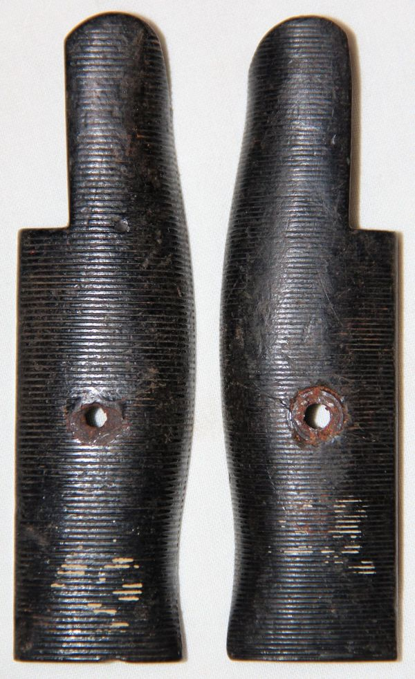 F015. WWII BLACK PLASTIC BAYONET GRIPS