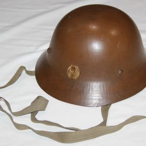 L014. NICE WWII JAPANESE CIVIL DEFENSE HELMET WITH POST WAR SCHOOL BADGE