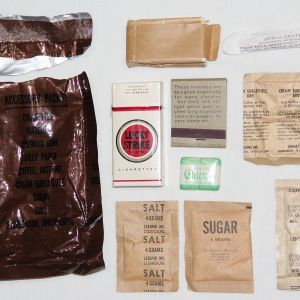 T074. OPENED VIETNAM C-RATION ACCESSORY PACK WITH LUCKY STRIKE CIGARETTES