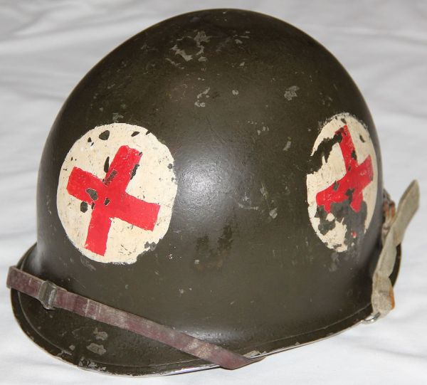 C034. WWII - KOREA FRONT SEAM, SWIVEL LOOP 4 PANEL MEDIC M1 HELMET WITH LINER