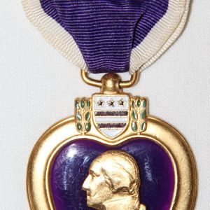 H055. WWII NAMED AND NUMBERED PURPLE HEART MEDAL