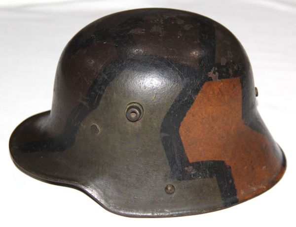 B191. WWI GERMAN CAMOUFLAGE M16 COMBAT HELMET