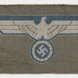 O.125. LATE WWII GERMAN PRINTED ARMY BREAST EAGLE