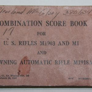 J075. WWII RIFLE COMBINATION SCORE BOOK NAMED TO AN AFRICAN AMERICAN