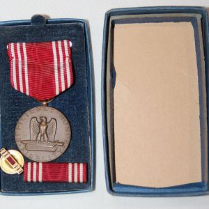 INCLUDES SLOT BROACH MEDAL, RIBBON BAR AND LAPEL PIN. COMES MOUNTED ON THE CARD IN A PARTIAL 1945 DATED BOX. ONLY THE LID OF THE BOX REMAINS, NO BOTTOM HALF. THE BOX HAS TAPED CORNERS. GOOD CONDITION. GUARANTEED ORIGINAL. FREE SHIPPING IN THE U.S.A. CLICK ON PHOTOS TO ENLARGE.
