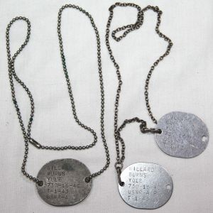 H114. THREE WWII US NAVY DOG TAGS NAMED TO ONE MAN