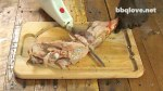 Cutting up the Leg, Thigh, Drum Stick with an electric knife on a wood cutting board. Butter Creole injection dripping out.