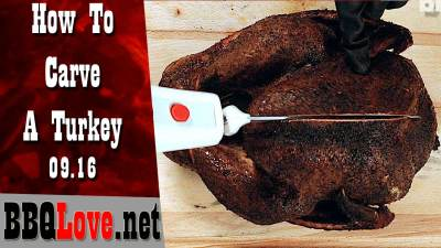 How To Carve a Turkey Cover Image Top Down view will electric knife, wood cutting board. Smoked Turkey