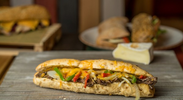 Philly cheesesteak sandwich on wooden board