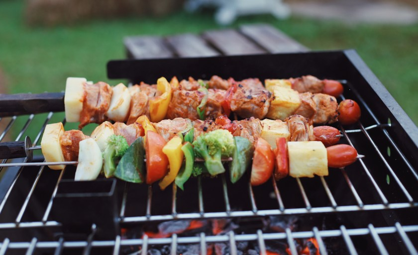 Kebabs on a hot grill being cooked