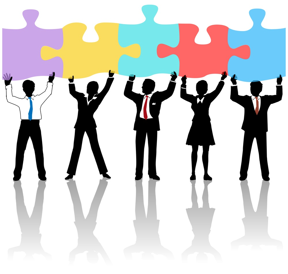 Team of business people collaborate holding up jigsaw puzzle pieces as a solution to a problem (image from Bigstock)