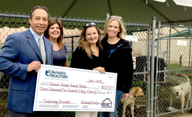 Board of REALTORS President Steve Ray (far left) and REACT Battle of the Bartenders co-Chair Tiffany Roberts (second right) were delighted to visit the Animal shelter and present the donations to Executive Director Tobie DeAngelus Petkus (second left) and Krista A. Wroldson Miller (far right) from the shelter.  Molly and Kahn look on excited to know that the funds were earmarked for permanent shade coverings for the large outdoor dog enclosures.